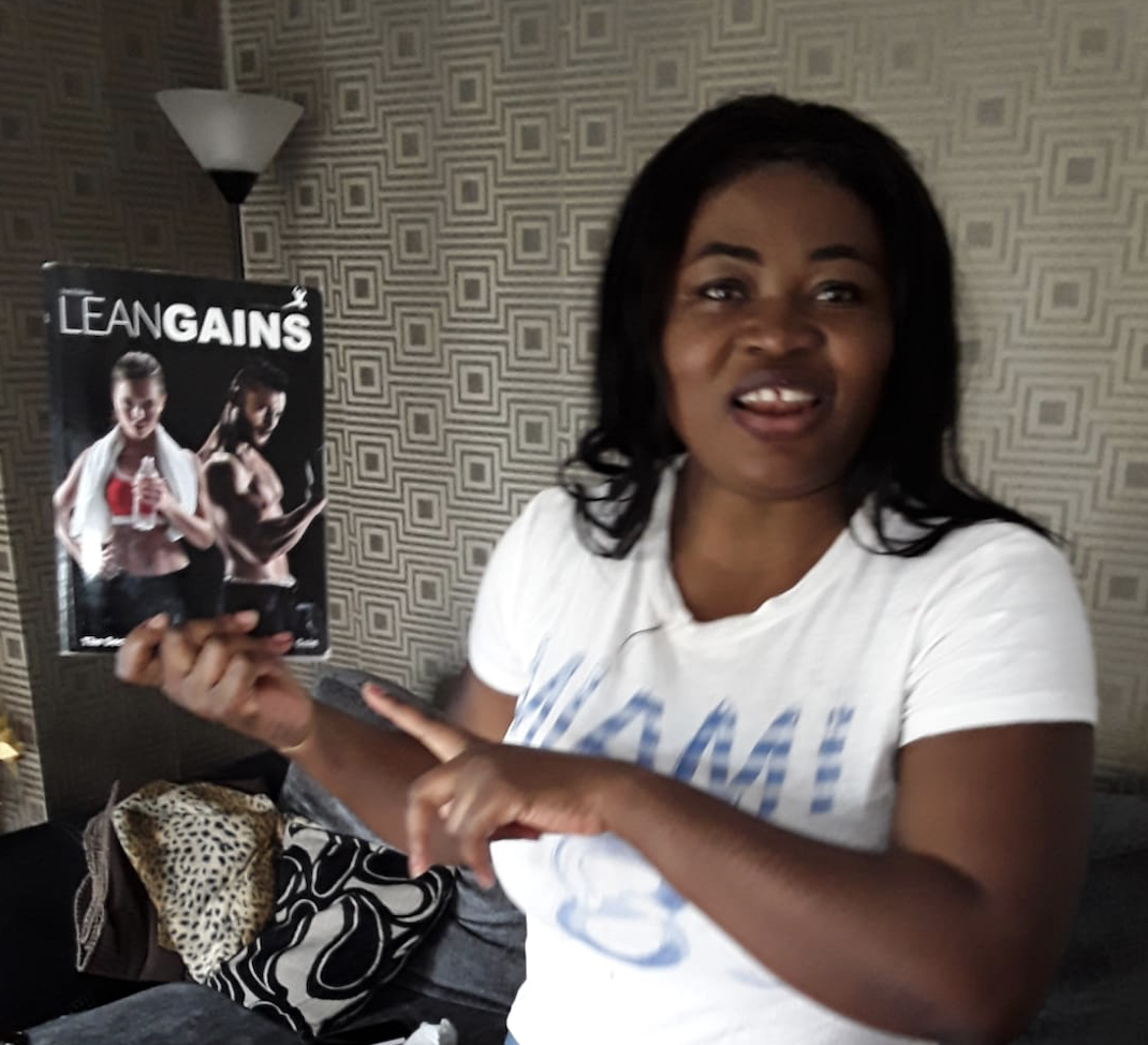 lady holding lean gains book