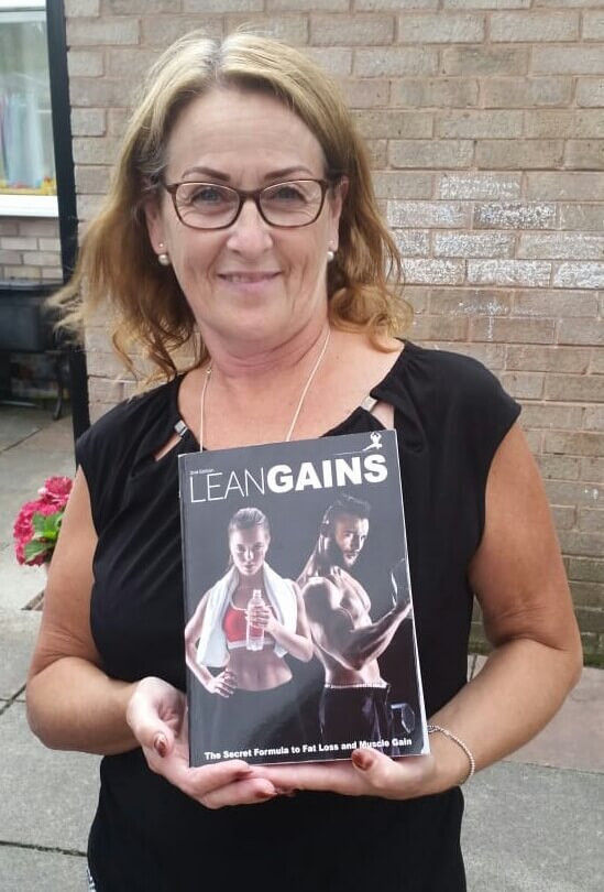 old lady holding fitness book lean gains
