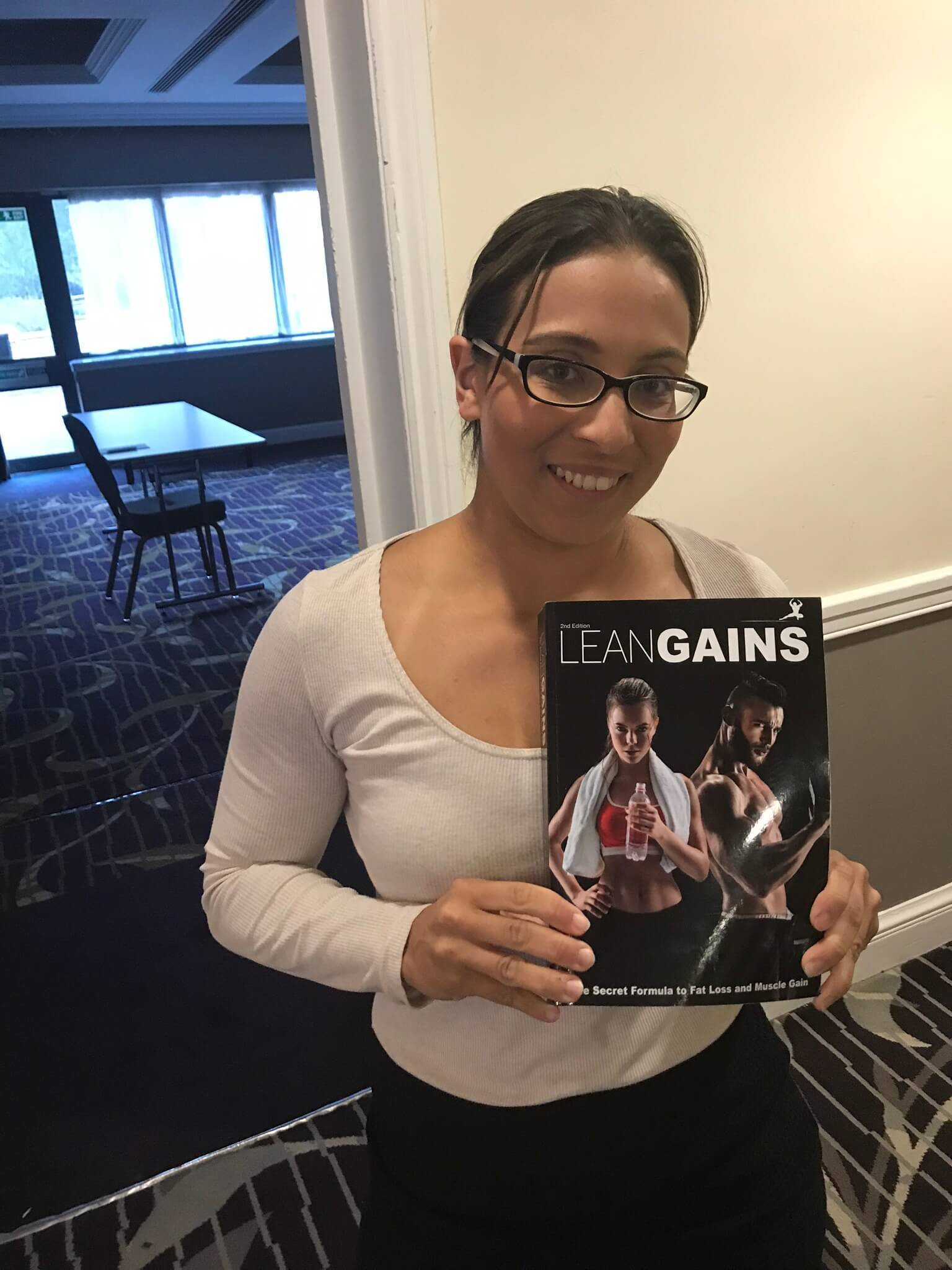 indian lady holding lean gains book
