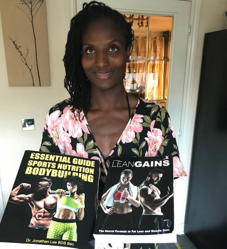 model holding fitness books