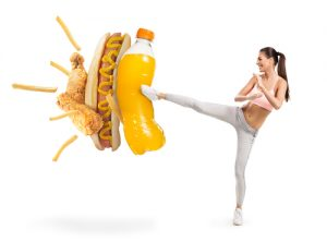woman kicking junk food
