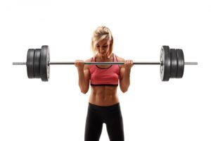 woman doing barbell curl
